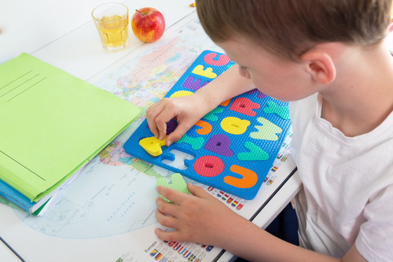 Boy learns with colorful letters